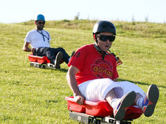 Things to do in Scotland. Grass sledging in the Borders